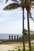 Easter island with palmtrees and statues Stock Photos