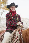 Cowgirl on horse - stock photo