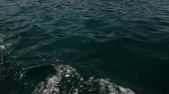 Shot of the trace that is making the boat on the water surface Stock Footage