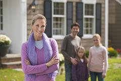 Family in front of house Stock Photos