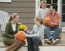 Family sitting on deck - stock photo