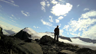 Stock Video Footage of Male Mountaineer professionally equipped for Peak climb, Alaska, USA
