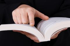 Stock Photo of business woman reading book