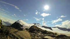 View of lone male climber nr distant helicopter, Alaska, USA - stock footage