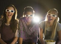 Young girls watching 3D movie Stock Photos