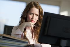 Stock Photo of Woman working at computer