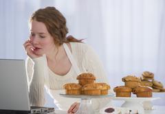 Woman baking and reading recipe Stock Photos