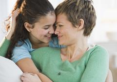Portrait of a mother and daughter - stock photo