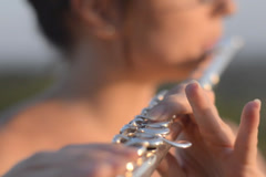 Female musician plays flute Stock Footage