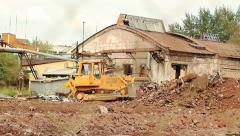 Heavy bulldozer shoveling debris Stock Footage