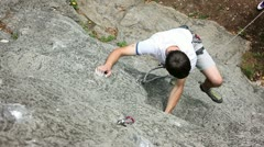 Man rock climbing in nature shot from above Stock Footage