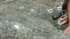 Close up of a hand of a man rock climbing in nature - stock footage