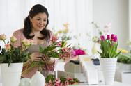 Stock Photo of Florist making a floral arrangement