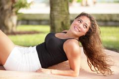 Stock Photo of Young woman relaxing in the park