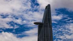 1080 - Skyscraper in Saigon - Cloudscape in background Stock Footage