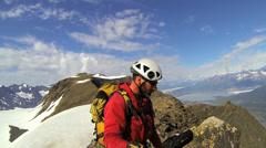 Peak Climber filming selfie to post online, Alaska, USA Stock Footage