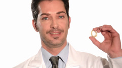 Medical doctor holding condom Stock Footage