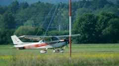 Close up of small airplane taking off Stock Footage