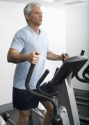 Man exercising on Stairmaster - stock photo
