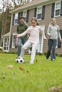 Family playing soccer - stock photo