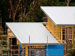 Peltikatto talonrakentamisen Kuvituskuvat