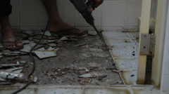 The tile floor demolishing by the constructor Stock Footage