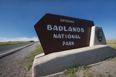 USA, South Dakota, Badlands National Park welcome sign on roadside Stock Photos