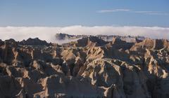 USA, South Dakota, Mountains in morning fog in Badlands National Park Stock Photos