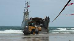 OIL SPILL DISASTER BUCKET LOADER BULLDOZER LANDING CRAFT Stock Footage