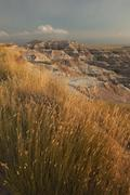 USA, South Dakota, Badlands National Park, Mountains with grass in foreground Stock Photos