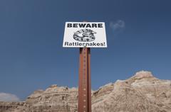 USA, South Dakota, Badlands National Park, Rattlesnake warning sign against sky, Stock Photos