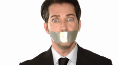 Businessman gagged with tape Stock Footage