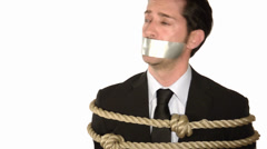 a tied up and gagged businessman - stock footage