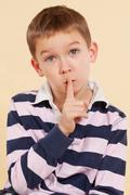the secret. finger over mouth. psst. - stock photo