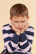 little angry offended boy. - stock photo