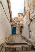 narrow street in mardin - stock photo