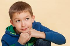 Boy thinking isolated. Stock Photos