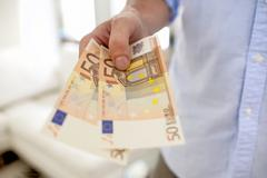 Hand holding european banknotes Stock Photos