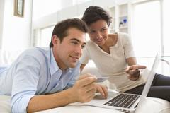 couple using credit card to shop online - stock photo