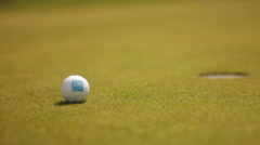 Golf ball on putting green Stock Footage