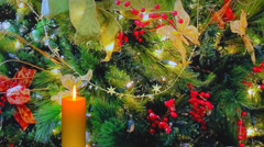 Golden holiday candle with red berries and decorations Stock Footage