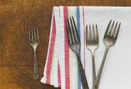 Stock Photo of Close up of rusty silver forks and napkin