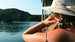 Young woman observing the landscape from the boat Stock Footage