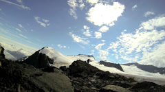 View of helicopter and male climber remote wilderness, Alaska, USA - stock footage
