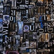 Stock Photo of Assortment of printing blocks with word YOU in the middle of picture
