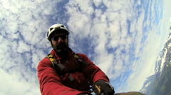 Climber maneuvering selfie video camera, Alaska, USA Stock Footage