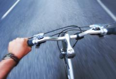 Hand gripping handlebar of bike Stock Photos