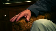 Close up shot of a tailors hand relaxing on a chair Stock Footage
