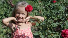 Child Smelling and Playing with Flowers, Little Girl Smelling Red Rose, Children Stock Footage