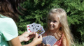 Mother and Child, Little Girl Playing Cards Game in Park, Happy Family Footage